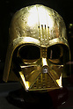 A gold plated Darth Vader mask on display at the Ginza Tanaka jewelry store in Ginza on November 19, 2015, Tokyo, Japan. In May 2015 Ginza Tanaka began launching Star Wars commemorative 24k gold coin sets, in prices ranging from 500 to 8000 USD. All the sets sold out and now the jewelry store is preparing a new piece to commemorate the film Star Wars The Force Awakens. (Photo by Rodrigo Reyes Marin/AFLO)