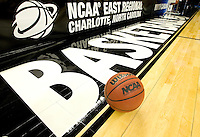 An official NCAA basketball rests on the court during the NCAA Basketball Men's East Regional at Time Warner Cable Arena in Charlotte, NC.