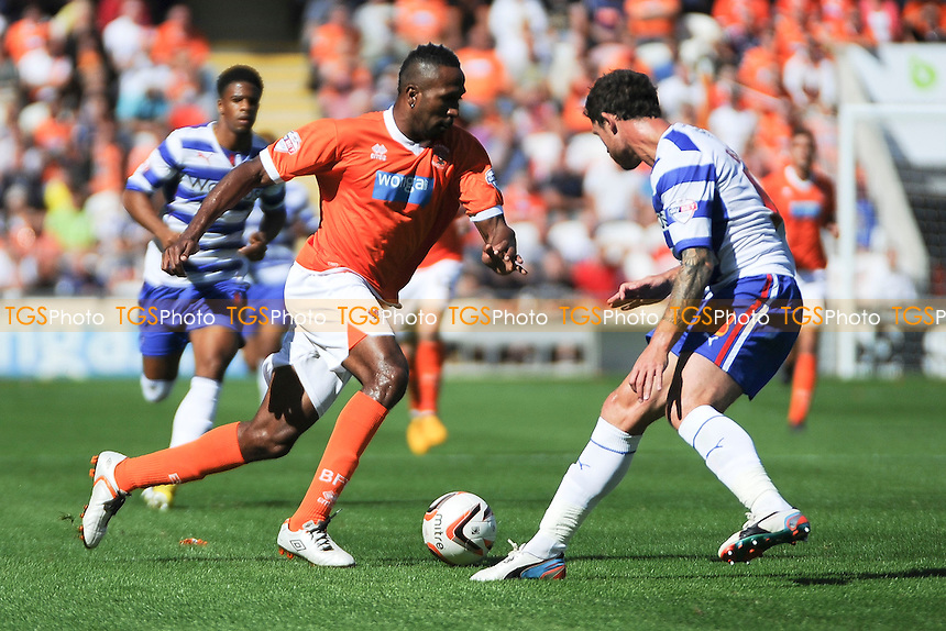 Ricardo Fuller of Blackpool controls the ball in front of Wayne Bridge of Reading - Blackpool vs Reading - Sky Bet Championship Football at Bloomfield Road, Blackpool, Lancashire - 24/08/13 - MANDATORY CREDIT: Greig Bertram/TGSPHOTO - Self billing applies where appropriate - 0845 094 6026 - contact@tgsphoto.co.uk - NO UNPAID USE