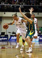 Tall Blacks guard Lindsay Tait drives past Matthew Delladova during the International basketball match between the NZ Tall Blacks and Australian Boomers at TSB Bank Arena, Wellington, New Zealand on 25 August 2009. Photo: Dave Lintott / lintottphoto.co.nz