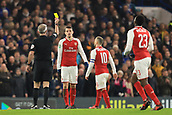 10th January 2018, Stamford Bridge, London, England; Carabao Cup football, semi final, 1st leg, Chelsea versus Arsenal; Granit Xhaka of Arsenal is shown the yellow card