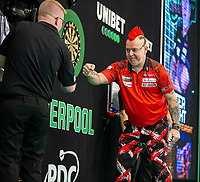 12th March 2020; M and S Bank Arena, Liverpool, Merseyside, England; Professional Darts Corporation, Unibet Premier League Liverpool; Peter Wright fist-bumps the scorer after winning his game