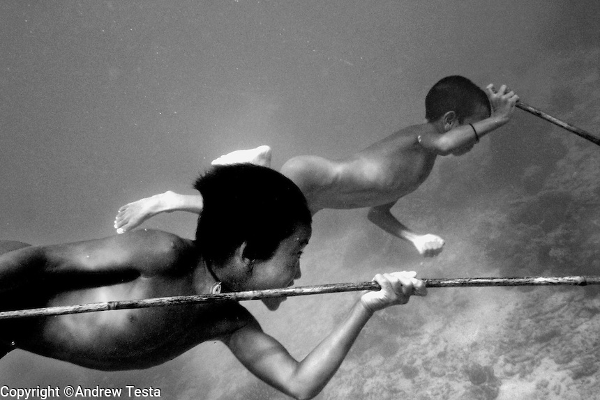 THE MOKEN..Moken boys fish with spears in the sea around the Surin Islands.The Moken are a nomadic tribe who live on these islands 60 km off the coast of Thailand. Recent scientific studies have shown that the underwater eyesight of Moken children is more than50% percent better than the underwater eyesight of other children. Scientists believe that the Moken train their eyes to see better out of necessity, they have to hunt for fish, and also make out things on the sea bed far below them. Experiments are now underway in Sweden to see if other children can train their eyes in a similar way.