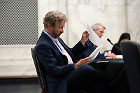 United States Senator Rand Paul (Republican of Kentucky) looks over notes during a U.S. Senate Committee on Homeland Security and Governmental Affairs meeting in the Senate Russell Office Building in Washington D.C., U.S., on Wednesday, May 20, 2020, to consider a motion to issue a subpoena to Blue Star Strategies.  Credit: Stefani Reynolds / CNP/AdMedia