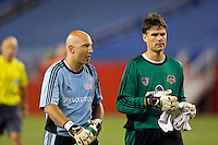 New England Revolution goalkeeper Matt Reis (1) and Houston Dynamo goalkeeper Pat Onstad (18) talk before the start of the penalty kick shootout. The New England Revolution defeated the Houston Dynamo 2-2 (6-5) in penalty kicks in the SuperLiga finals at Gillette Stadium in Foxborough, MA, on August 5, 2008.