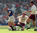Ally McCoist tries his best to go down for a penalty as David Weir makes a last gasp clearance to deny the Rangers striker in the Scottish Cup final 1998, this was McCoist's last ever match for Rangers