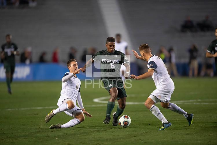 Santa Barbara, CA - Friday, December 7, 2018:  Akron men's soccer defeated Michigan State 5-1 in a semi-final match in the 2018 College Cup.  Michigan State's Delan Jones advances the ball.