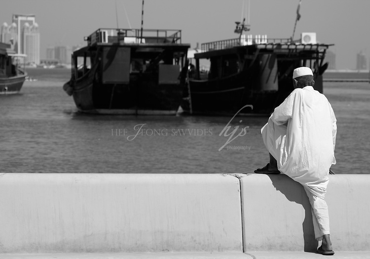 Local man on the Corniche, looking at the Dhow boats, Doha, Qatar | Sept 09