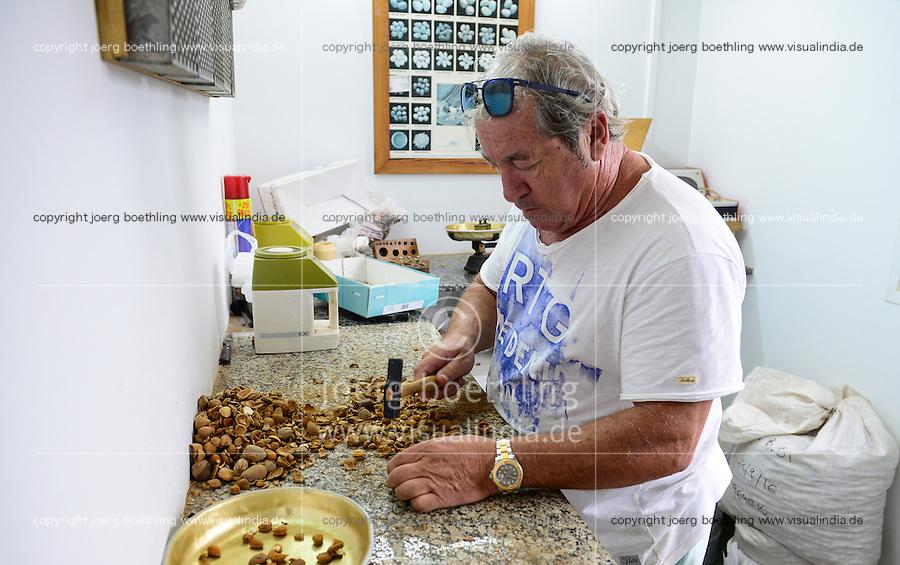 SPAIN Mallorca, Petra, bonany company, processing of almonds  / SPANIEN Mallorca, Petra, Firma bonany, Verarbeitung mallorquinischer Mandeln, Inhaber Pep Rausell in der Qualitaetskontrolle