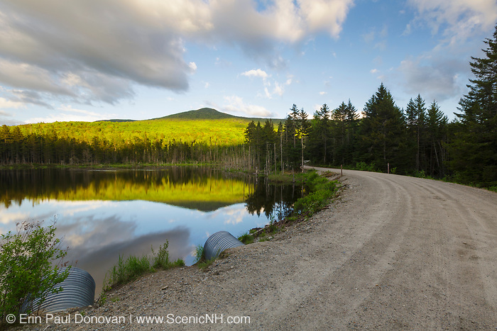 Reflection of Mount Deception in a small pond along Old Cherry Mountain Road in Carroll, New Hampshire USA during the spring months.