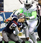 SIOUX FALLS, SD - FEBRUARY 21:  Roy Polite #6 from the Sioux Falls Storm has his helmet ripped off on a face mask by Jervonte Jackson #99 from the Nebraska Danger in the first quarter of their game Friday night at the Sioux Falls Arena. (Photo by Dave Eggen/Inertia)