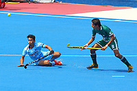 India's Pardeep Mor competes with Pakistan's Muhammad Yaqoob during the Hockey World League Semi-Final match between Pakistan and India at the Olympic Park, London, England on 18 June 2017. Photo by Steve McCarthy.