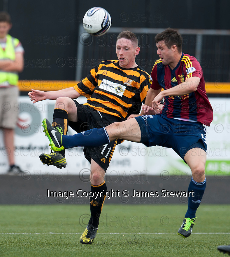 Livy's Callum Fordyce clears from Alloa's Declan McManus.
