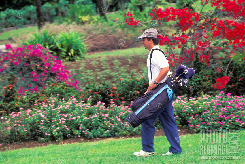 Man playing golf at Nani Mau Gardens, Big Island