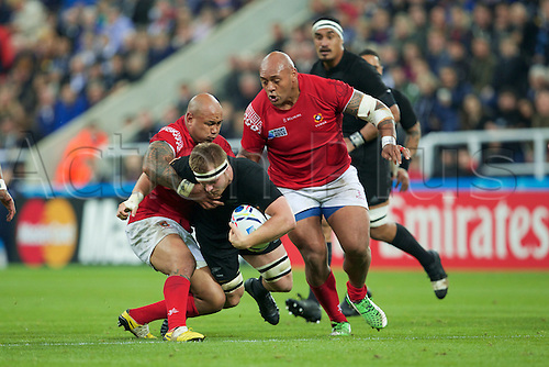 09.10.2015. St James Park, Newcastle, England. Rugby World Cup. New Zealand versus Tonga. New Zealand All Black flanker Sam Cane is tackled by Tonga wing Fetu'u Vainikolo.