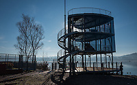 Varese, Lombardia, ITALY. General View, as the sun rises, and burns of the mist/fog at the Varese Rowing Club. [Canottieri Varese, Glass and Steel Modern styled Finish Tower,<br />
