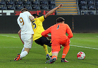 Pictured L-R: Alex Bray of Swansea pushes against Easah Suliman and goalkeeper Matija Sarkic of Aston Villa Monday 25 April 2016<br /> Re: Play Off semi final, Swansea City AFC U21 v Aston Villa FC U21 at the Liberty Stadium, Swansea, UK