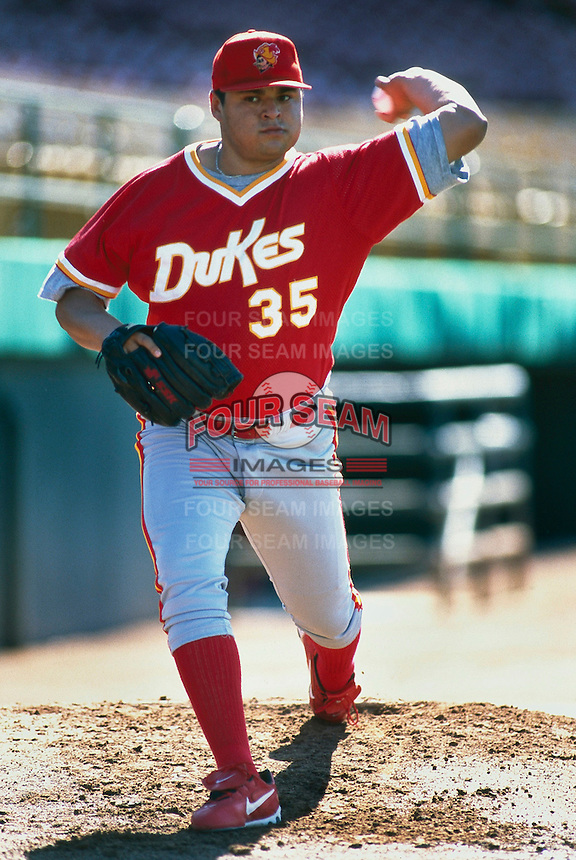 Dennys Reyes of the Albuquerque Dukes during a game at Cashman Field in Las Vegas, Nevada during the 1997 season.(Larry Goren/Four Seam Images)