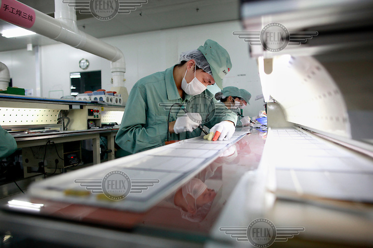 A scientist at work at the Suntech factory, the world's largest producer of solar panels.