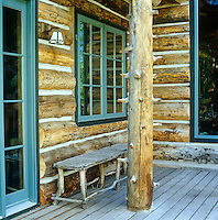 Green-painted woodwork contrasts with the natural texture of exposed wood on the deck of a lodge in Aspen, Colorado