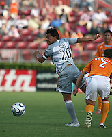 FC Dallas forward Carlos Ruiz (20) attempts to turn the ball during an MLS regular season match against the Houston Dynamo at Robertson Stadium in Houston, TX on August 19, 2007.