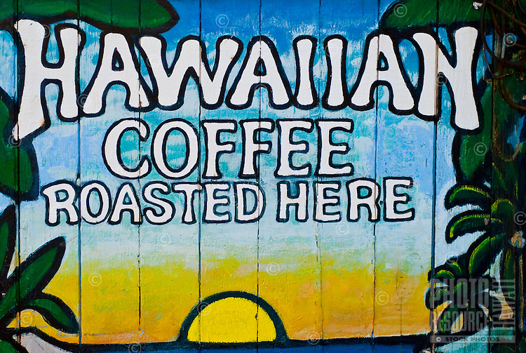 A sign on the side of a building in downtown Paia