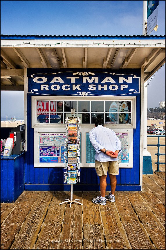 Guy looking at maps on Santa Monica Pier | Van Chaplin ... on walt disney concert hall map, santa monica college map, pier 39 map, south coast botanic garden map, santa monica airport map, the getty center map, grauman's chinese theatre map, playa del rey ca map, aquarium of the pacific map, knott's berry farm map, 3rd street promenade map, santa monica mountains map, santa monica high school map, cbs studios map, house of blues anaheim map, pacific park map, san quentin state prison map, old mission santa barbara map, oaks amusement park map, morey's piers map,