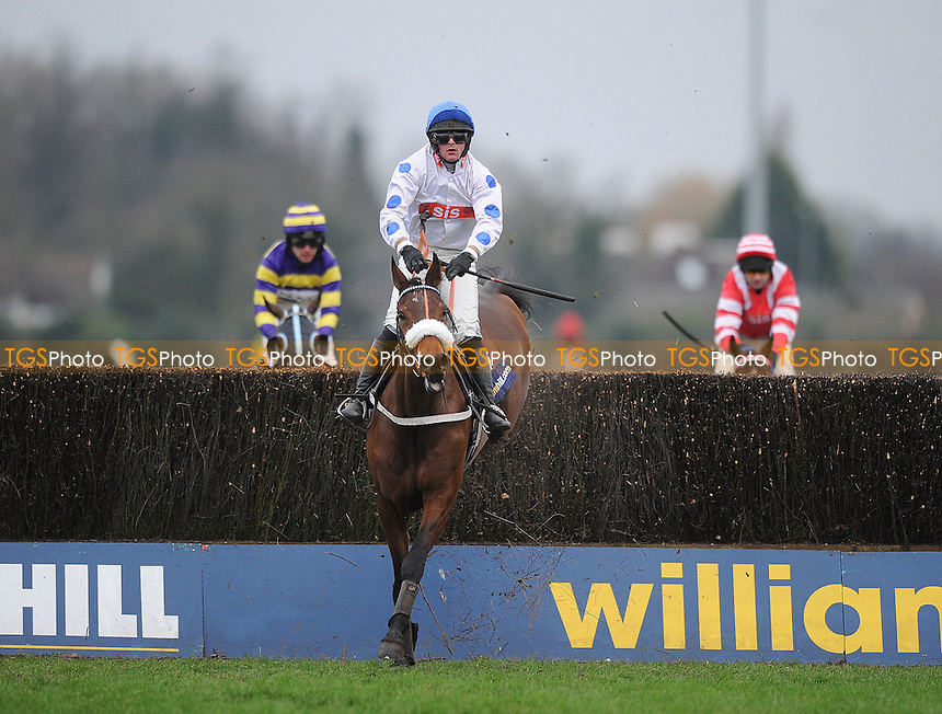 Brackloon High ridden by Mr N de Boinville jumps the last and goes on to win the William Hill - Download The App Handicap Chase Cl2 - Horse Racing at Kempton Park Racecourse - 12/01/2013 - MANDATORY CREDIT: Martin Dalton/TGSPHOTO - Self billing applies where appropriate - 0845 094 6026 - contact@tgsphoto.co.uk - NO UNPAID USE.