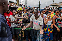 MONROVIA, LIBERIA - AUGUST 23, 2014:   Residents beg Liberian Police for assistance as they voiced their grievances over lack of basic supplies during the fourth day of the government's Ebola quarantine on their neighbourhood on August 23, 2014 in Monrovia, Liberia. The residents of Westpoint neighbourhood are forbidden from leaving the seaside slum, due to the Ebola outbreak in their community. More than 1,400 people have died due to the Ebola epidemic in West Africa.<br /> <br /> Daniel Berehulak for The New York Times