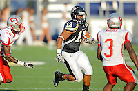 9 October 2010:  FIU linebacker Toronto Smith (13) returns a fumble recovery in the third quarter as the FIU Golden Panthers defeated the Western Kentucky Hilltoppers, 28-21, at FIU Stadium in Miami, Florida.