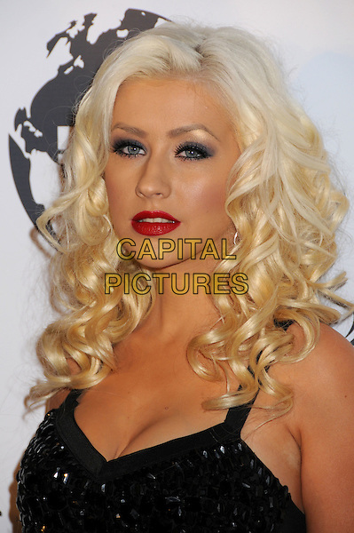 CHRISTINA AGUILERA .Attending The Nakheel Introduction of The Trump International Hotel & Tower Dubai held at The Tar Estate in Bel Air, California on August 23rd 2008.                                                                     .portrait headshot purple eyeshadow black red lipstick curly hair.CAP/ADM/BP.©Byron Purvis/Admedia/Capital PIctures