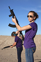 "USA. Arizona state. Peoria. Peoria is distant 50 km from Phoenix. Cowtown Shooting Range. Cowtown is a semi-private outdoor shooting range and firearms training facility. Carrie Lightfoot (L) holds a Beretta 1301 Tactical Semi-Auto 12-Gauge Shotgun while her colleague Ashley Suris an AK-47. Both women train their shooting skills with two semi-automatic rifles. Carrie Lightfoot is the founder and CEO of ""The Well Armed Woman. Where the Feminine and Firearms Meet"" which sell online resources for women gun owners. The Beretta 1301 Tactical is a gas operated semi-automatic shotgun designed for law enforcement and home defense. The AK-47 (also known as the Kalashnikov, AK, or Kalash) is a selective-fire automatic or semi-automatic gas-operated 7.62×39mm assault rifle, developed in the Soviet Union by Mikhail Kalashnikov. A firearm is a portable gun, being a barreled weapon that launches one or more projectiles often driven by the action of an explosive force. Most modern firearms have rifled barrels to impart spin to the projectile for improved flight stability. The word firearms usually is used in a sense restricted to small arms (weapons that can be carried by a single person). The right to keep and bear arms is a fundamental right protected in the United States by the Second Amendment of the Bill of Rights in the Constitution of the United States of America and in the state constitutions of Arizona and 43 other states. 28.01.16 © 2016 Didier Ruef"