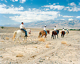 USA, California, Death Valley National Park, people horseback riding, Furnace Creek Stables