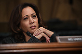 Sen. Kamala Harris, D-CA, listens to Christine Blasey Ford, the woman accusing Supreme Court nominee Brett Kavanaugh of sexually assaulting her at a party 36 years ago, testifying before the US Senate Judiciary Committee on Capitol Hill in Washington, DC, September 27, 2018.  / POOL / SAUL LOEB