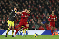 1st February 2020; Anfield, Liverpool, Merseyside, England; English Premier League Football, Liverpool versus Southampton; Jack Stephens of Southampton earns a yellow card for pulling down Roberto Firmino of Liverpool as he attempts to run through on goal