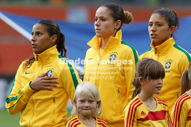 WOLFSBURG, GERMANY - JULY 3:  Fabiana, Erika and Cristiane of Brazil (L-R) stand for the Brazilian national anthem before a FIFA Women's World Cup Group D match against Norway at Arena Im Allerpark on July 3, 2011 in Wolfsburg, Germany.  Editorial use only.  Commercial use prohibited.  No push to mobile device usage.  (Photograph by Jonathan P. Larsen)