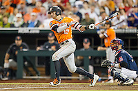 Oklahoma State Cowboys outfielder John Littell (13) follows through on his swing against the Arizona Wildcats during Game 6 of the NCAA College World Series on June 20, 2016 at TD Ameritrade Park in Omaha, Nebraska. Oklahoma State defeated Arizona 1-0. (Andrew Woolley/Four Seam Images)