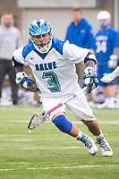 Jake Gonzalez,'17, moves into position during the Men's Lacrosse game action at Gaudet Field in Middletown.