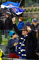A Bath Rugby fan in the crowd waves a flag in support after the match. Heineken Champions Cup match, between Leinster Rugby and Bath Rugby on December 15, 2018 at the Aviva Stadium in Dublin, Republic of Ireland. Photo by: Patrick Khachfe / Onside Images