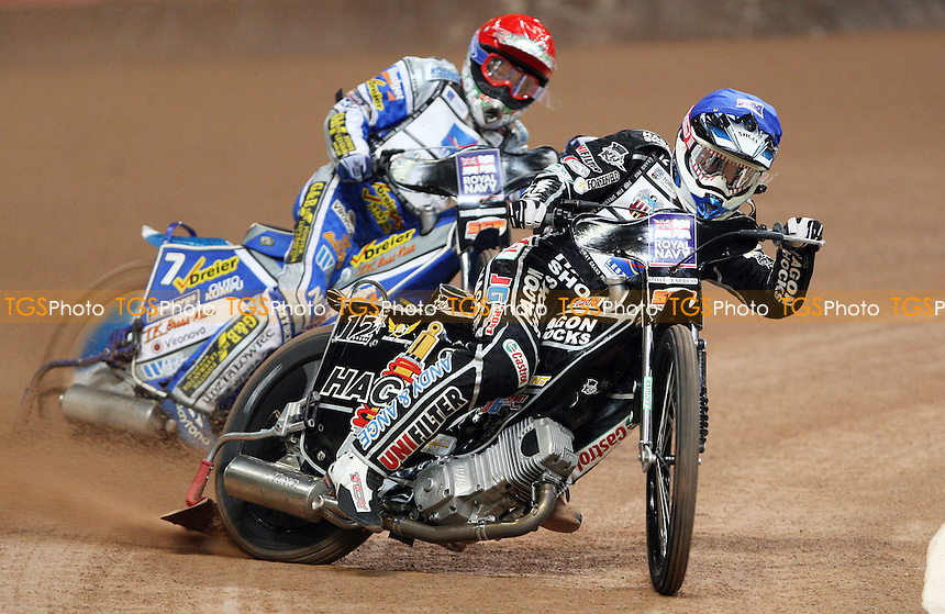Heat 1: Chris Holder (blue) and Rune Holta (red) - British Speedway Grand Prix at the Millennium Stadium, Cardiff - 10/07/10 - MANDATORY CREDIT: Rob Newell/TGSPHOTO - Self billing applies where appropriate - 0845 094 6026 - contact@tgsphoto.co.uk - NO UNPAID USE.