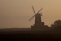 Cley Next The Sea, Norfolk, England, 09/08/2009..Mist surrounding Cley windmill just after dawn.