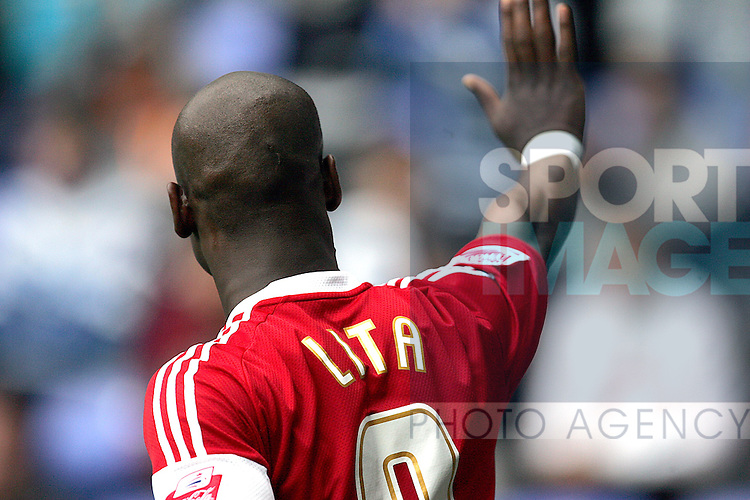 Leroy Lita of Middlesbrough apologises to the Reading fans after scoring against their side