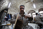 Palestinian blind men work in making brooms at a workshop in the Old City of Jerusalem on Dec. 07, 2013. The workshop is owned and managed by the Arab Blind Association, which was founded by blind Palestinians in 1932, and has then set up a number of workshops employing blind Arabs, as well as offering financial aid projects to blind. Photo by Saeed Qaq