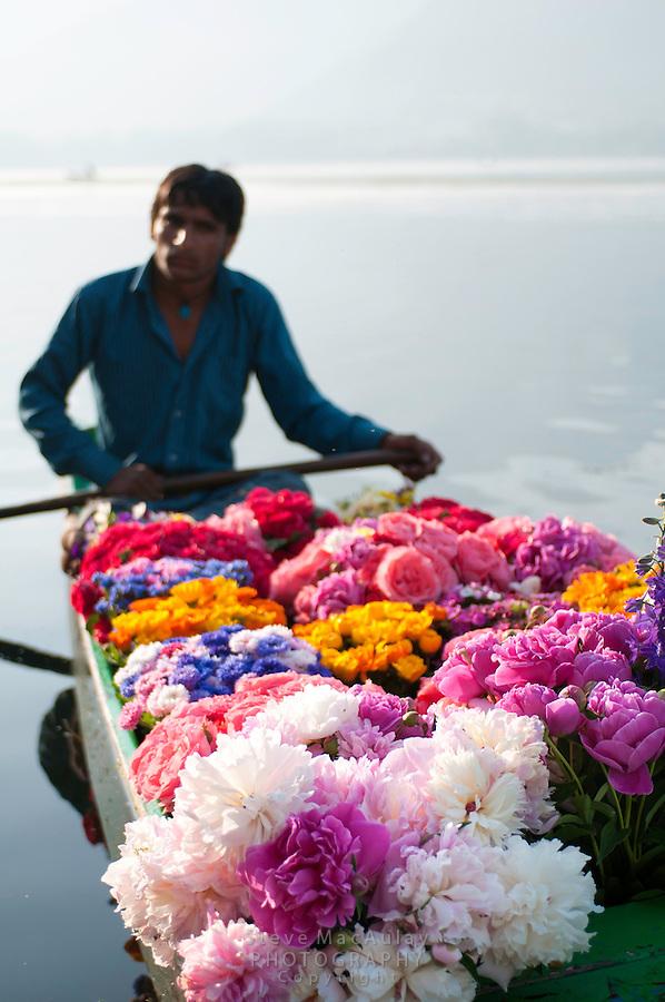 Beautiful flowers for sale in traditional Kashmiri shikara, Dal Lake, Srinagar, Kashmir, India.
