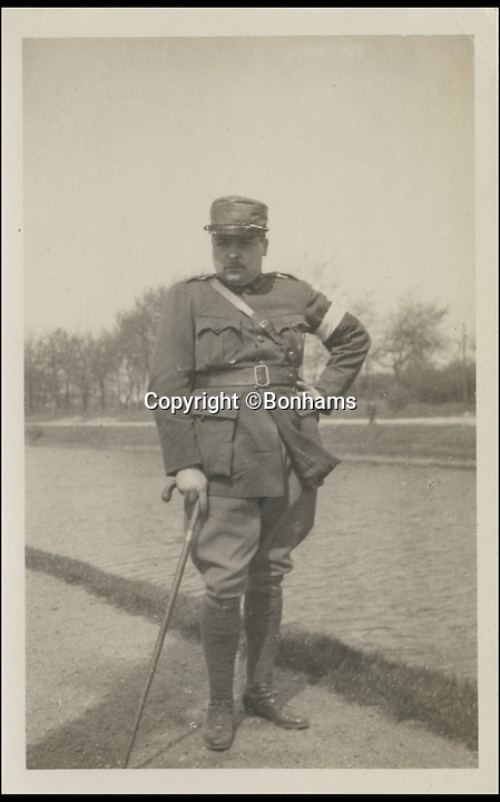 BNPS.co.uk (01202 558833)<br /> Pic: Bonhams/BNPS<br /> <br /> ***Please Use Full Byline***<br /> <br /> G. de la Rochefoucauld on a canal topath between Bergues and Dunkirk, May 1915. Image taken by the Prince of Wales. <br /> <br /> <br /> <br /> A remarkable album of photographs taken by the future King Edward VIII during a 'sight seeing' tour of the Western Front 99 years ago has come to light.<br /> <br /> Edward, Prince of Wales, took his own camera with him on his morale-boosting visit to the front-line in France in 1915.<br /> <br /> The young Royal took scores of snaps which included a gang of captured German soldiers, shell holes, bomb damaged buildings and British troops practising throwing hand grenades.<br /> <br /> He also snapped numerous Army officers he met on the visit and posed for several photos as well.