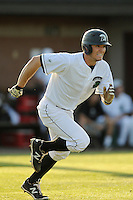 Right fielder Cody Brittain (18) of the University of South Carolina Upstate Spartans runs to first in a game against the College of Charleston Cougars on Tuesday, March 31, 2015, at Cleveland S. Harley Park in Spartanburg, South Carolina. Charleston won, 10-0. (Tom Priddy/Four Seam Images)