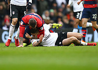 17th March 2018, Craven Cottage, London, England; EFL Championship football, Fulham versus Queens Park Rangers; Pawel Wszolek of Queens Park Rangers grabs Aleksandar Mitrovic of Fulham by the neck during a tussle on the pitch