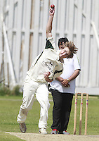 Fred Issitt bowls for North London during the Middlesex County Cricket League Division Three game between North London and South Hampstead at Park Road, Crouch End on Sat June 21, 2014.