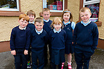 Eight new Juniors started school in Boheshill NS on Monday pictured here l-r; Christopher Collins, Conor O'Shea, Ronan McDonnell, Donnacha O'Shea, Michelle Murphy, Caoimhe Russell, James Sheehan and missing from photo Michael Foley.