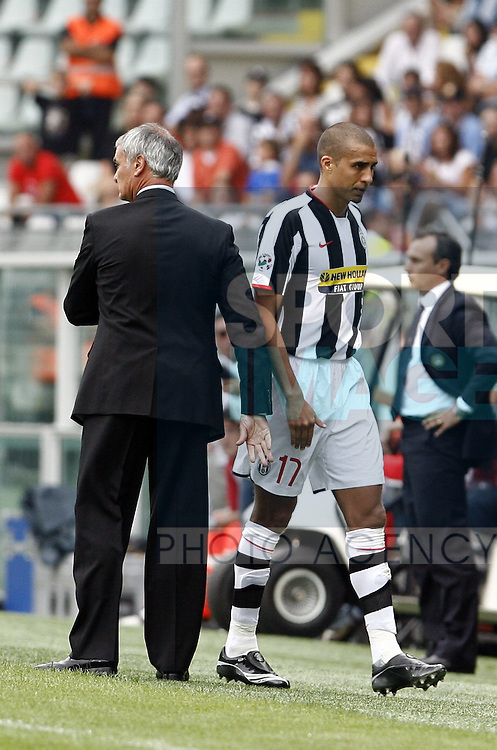 Juventus' David Trezeguet substituted walks past coach Claudio Ranieri